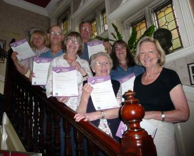 Volunteers with certificates